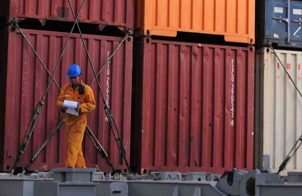 Man walking in front of storage containers at a rented facility in need of landlord insurance