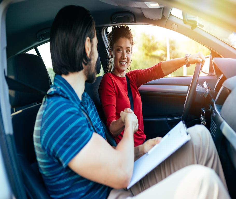 Teen Driving In Car with Driving School Instructor