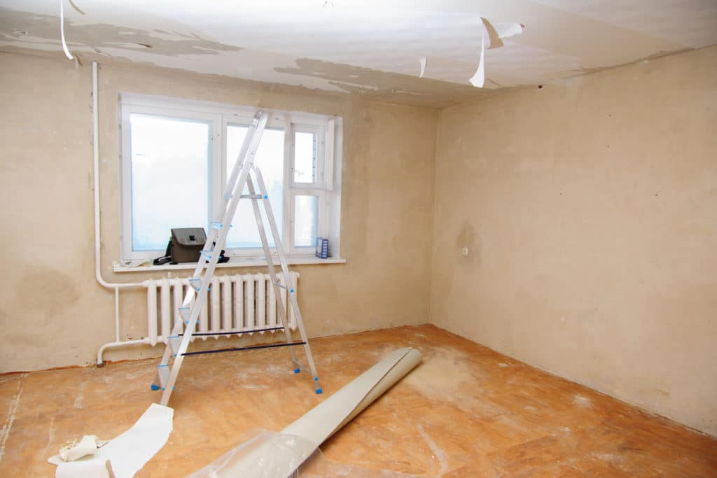 repairing the drywall after water damage.