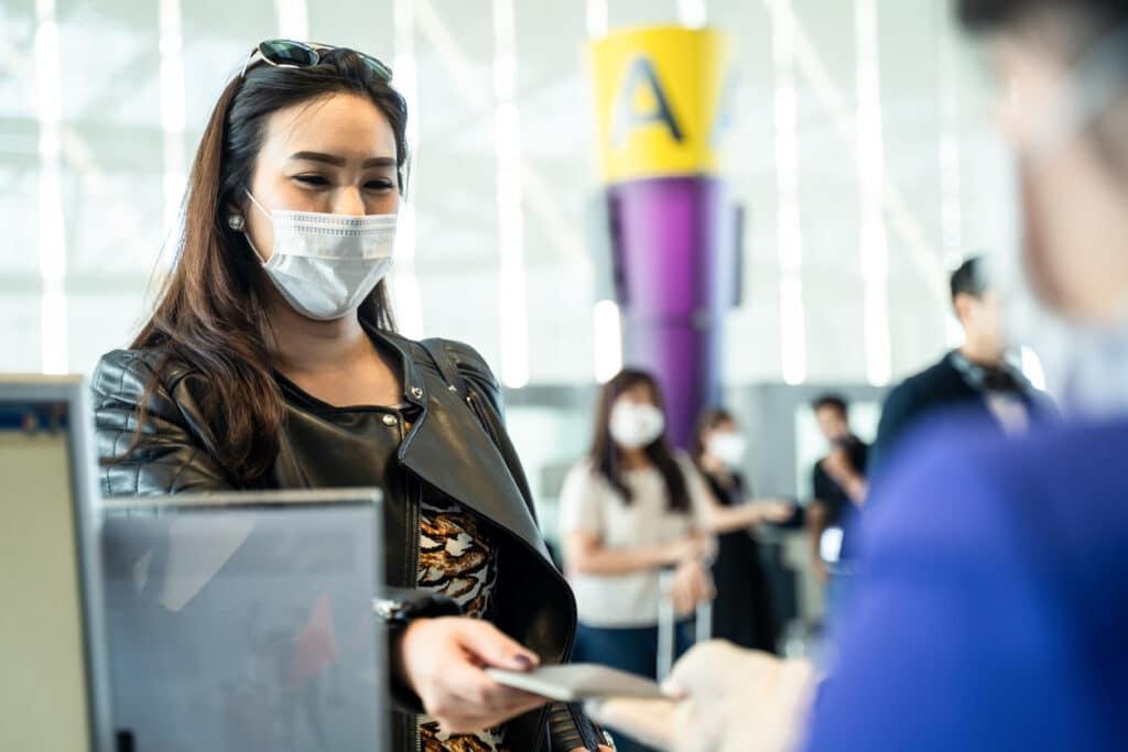woman handing over a REAL ID to tsa agent